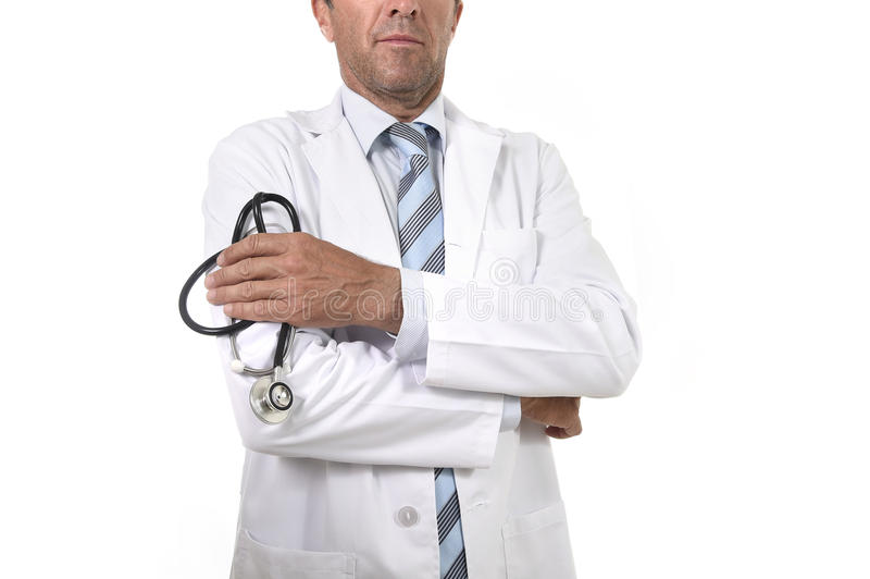 Anonymous crop face male medicine doctor holding stethoscope in his hand wearing medical gown. Standing proud in corporate portrait isolated on white background royalty free stock images