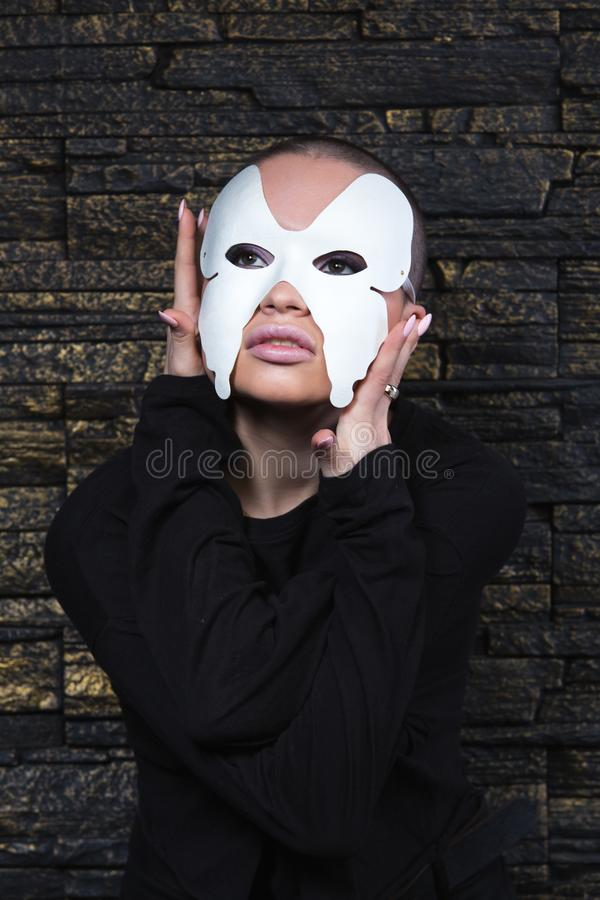 Shaved young model in mask royalty free stock photo