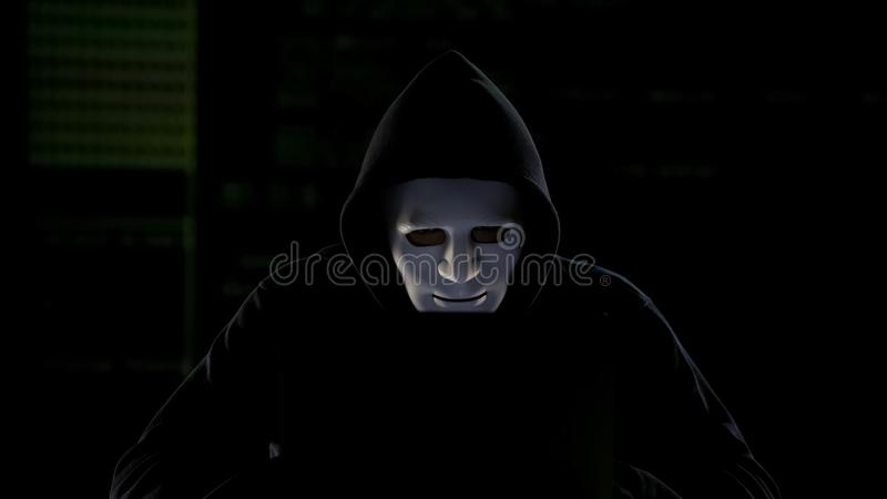 Anonymous hacker breaking government servers, cyber terrorism, internet security stock images