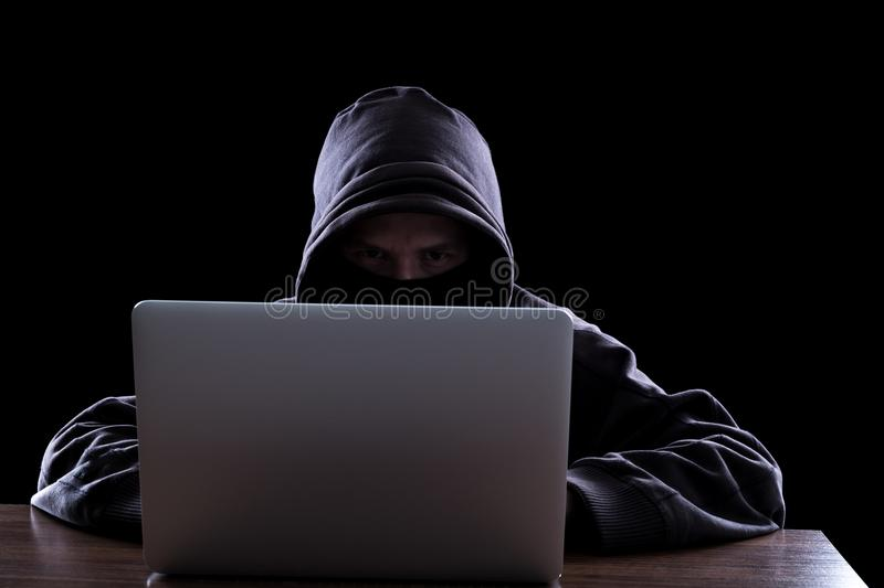 Anonymous hacker in the dark royalty free stock image