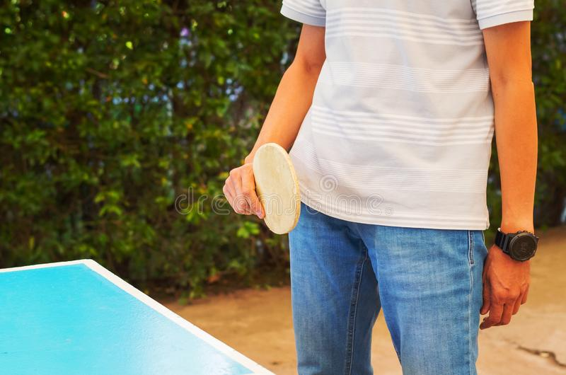 Anonymous man with a racket playing table tennis. stock photography