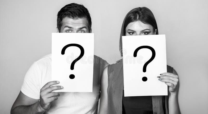 Anonymous, man and woman question. Problems and solutions. Getting answers. Portrait of couple holding paper question royalty free stock image
