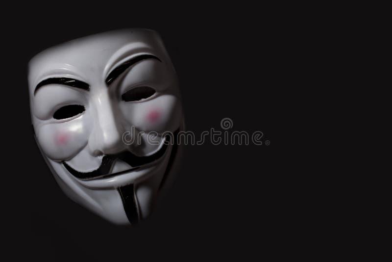 Anonymous mask. On black background royalty free stock photo