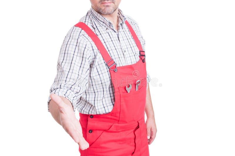 Anonymous mechanic or plumber offering handshake stock image