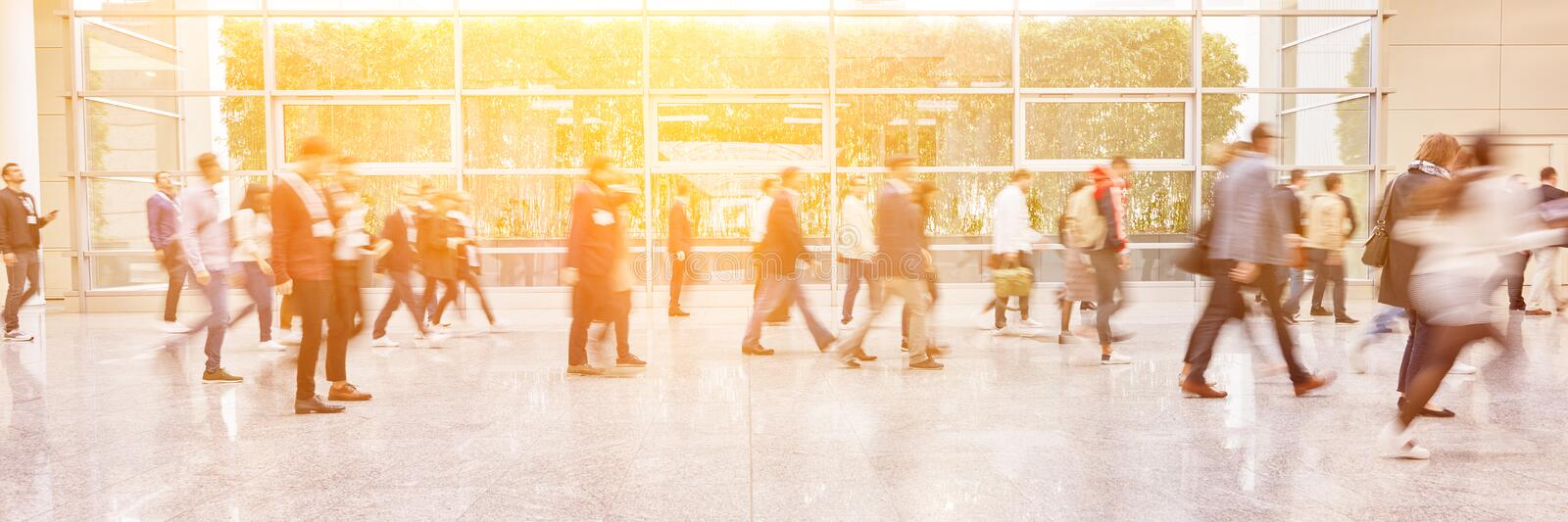 Anonymous people go to mass in the summer. As a panorama header stock photo