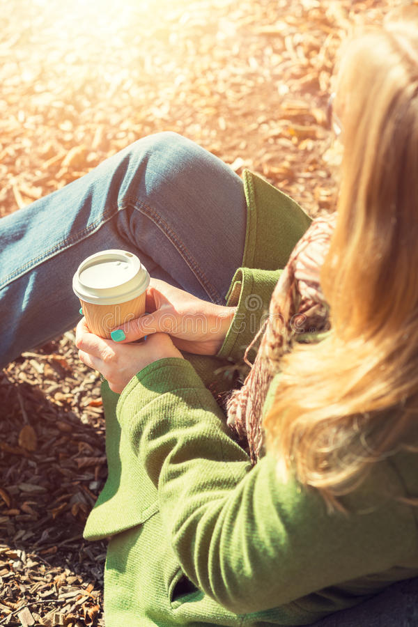 Free Anonymous Woman Enjoying Takeaway Coffee Cup On Sunny Cold Fall Day Stock Photo - 60803620