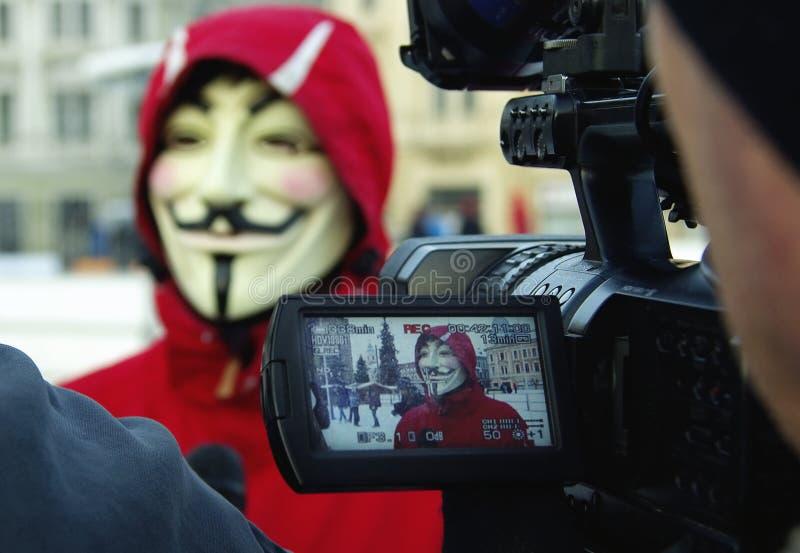 Anonymus Protestant gegen ACTA lizenzfreie stockbilder