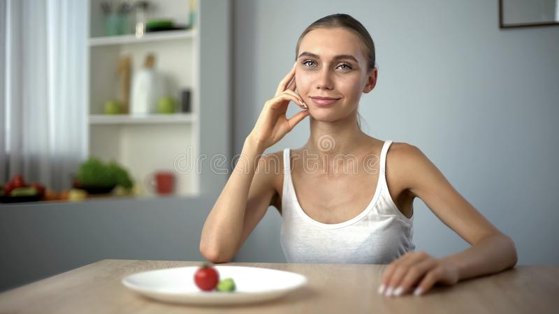 Anorexic girl smiling, conscious choice of severe diet, starving body, bulimia. Stock photo royalty free stock images