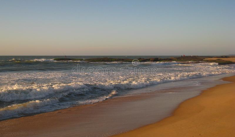 Another Dawn Take on Cavaleiros Beach, RJ, Macae, Brazil. Incoming Tide and Coastal Fishing in early morning Cavaleiros Beach, Macae, RJ, Brazil stock photo