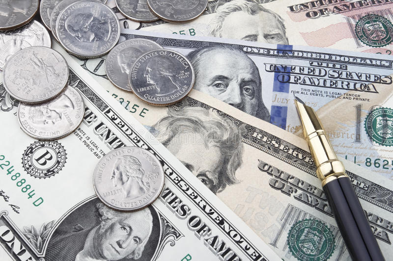 Another day at the office (USD coins and banknotes). US Dollar (USD) banknotes and coins stock image