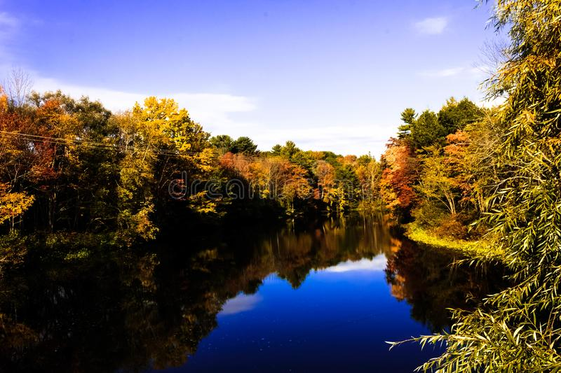 Another View of Fall Foliage on the Stroudwater River Windham, Me. Another peaceful scene of the autumn colors on the upper Stroudwater River. I love the images stock photo