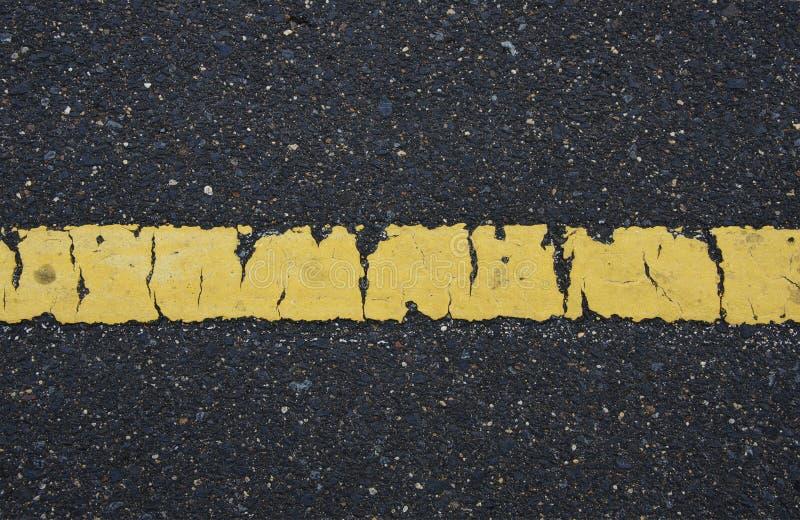 Anphalt texture background. Black alphalt texture background and yellow line royalty free stock image