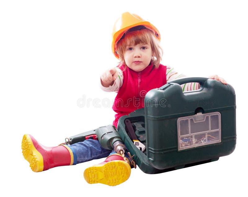 2 ans d'enfant avec des outils au-dessus de blanc images stock