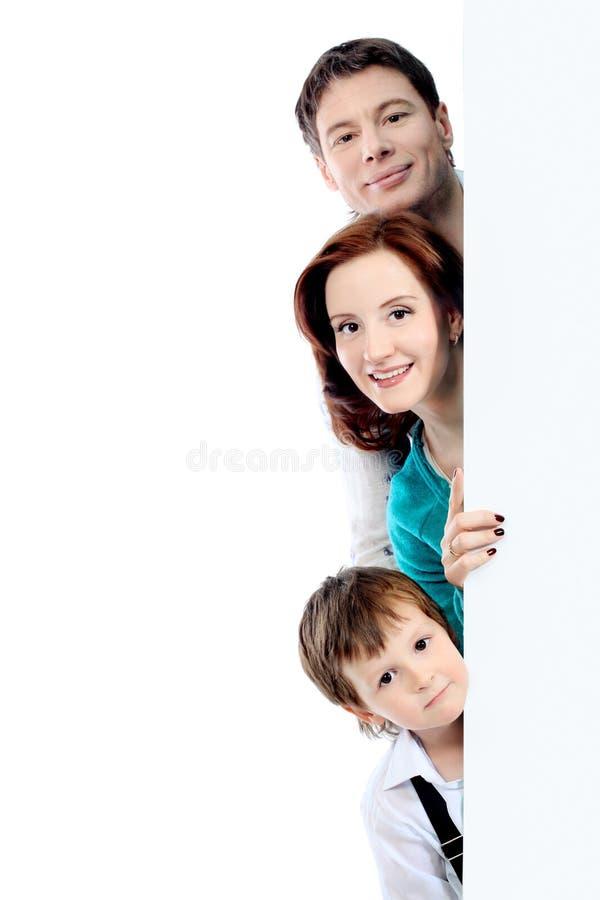 Anschlagtafel und Familie stockfotografie