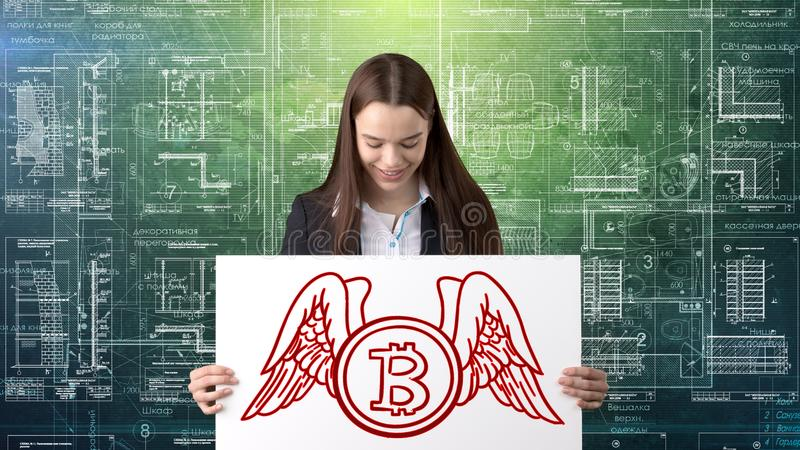 Anseende för Bauty affärskvinna i dräkt med den Bitcoin logoen som illustrerar bruket av bitcoin för att handla eller pengaröverf royaltyfria bilder