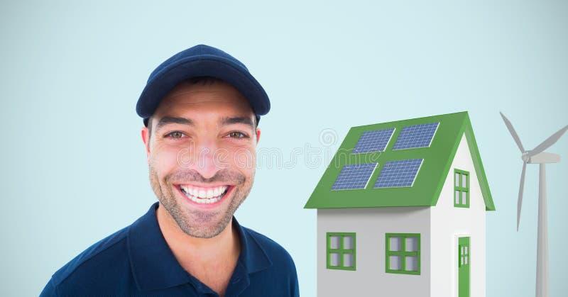Anseende för leveransman vid huset och väderkvarnen mot blå bakgrund fotografering för bildbyråer