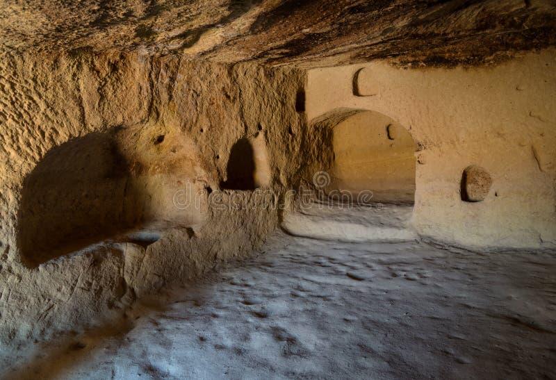 Ansicht innerhalb des stein-geschnittenen Höhlenhauses, Nationalpark Goreme, Untertagestadt, Cappadocia die Türkei lizenzfreie stockbilder