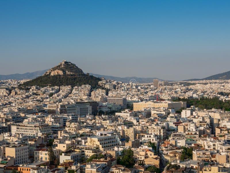 Ansicht von Athen, von Griechenland und von Berg von Lycabettus von Acropolus bei Sonnenuntergang stockfotos