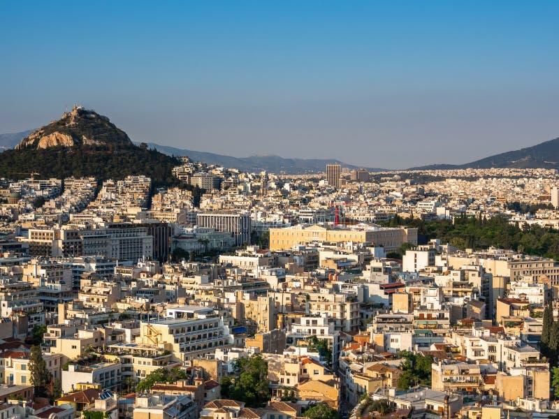 Ansicht von Athen, von Griechenland und von Berg von Lycabettus von der Akropolise bei Sonnenuntergang stockfotos