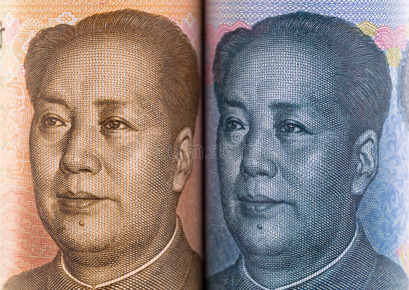 Ansikts- del av kinesiska yuansedlar med framsidan av Mao Zedong arkivfoton