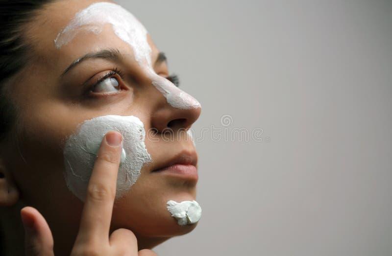 ansikts- maskering arkivfoto
