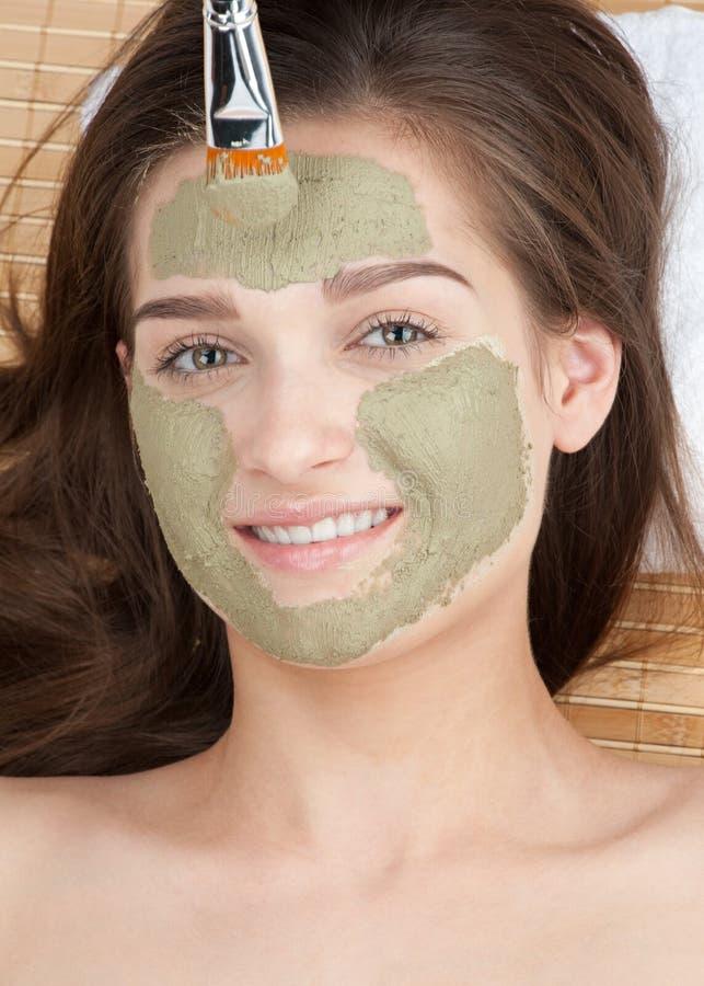 ansikts- maskeringskvinna för lera fotografering för bildbyråer