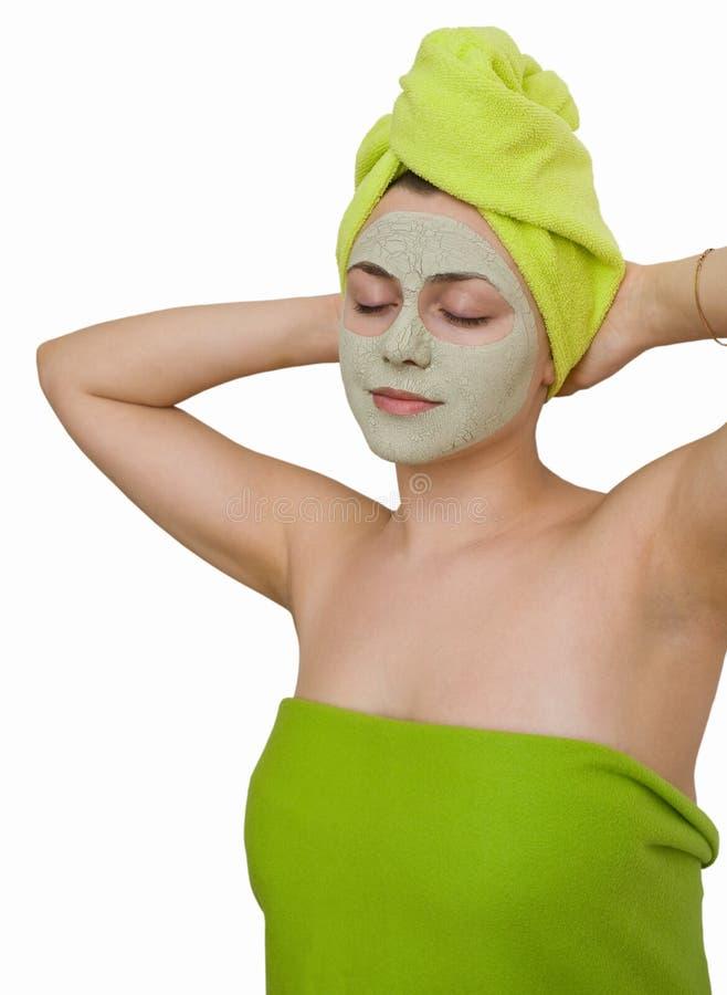 ansikts- maskeringskvinnabarn arkivfoto