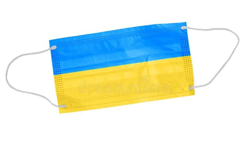 Ansiktsmask med ukrainsk flagg Begreppet hälsoproblem Koncept för kirurgi och bekämpning av coronavirus i Ukraina royaltyfri bild