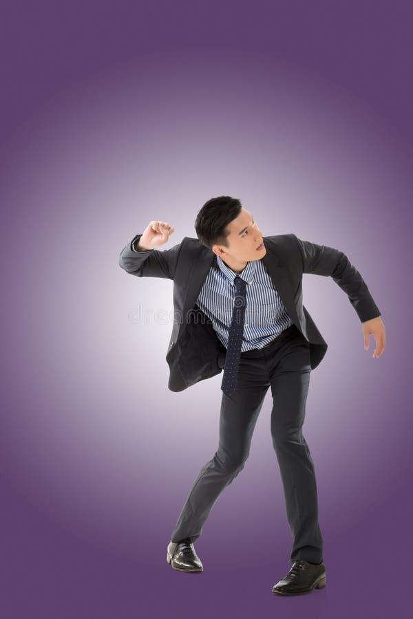 Ansträngning poserar av asiatisk affärsman fotografering för bildbyråer