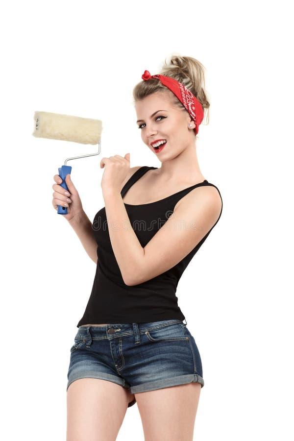 Anstrichwand der jungen Frau lizenzfreie stockfotos