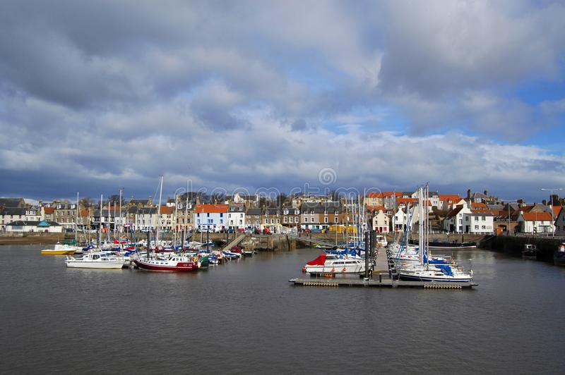 Anstruther Marina And Town. Anstruther marina viewed from the breakwater with the town in the background stock images
