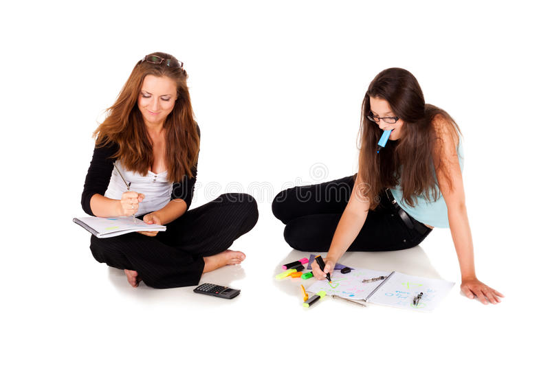And the answer is... Two students are solving their homework NOTE: Isolation with shadows stock photography