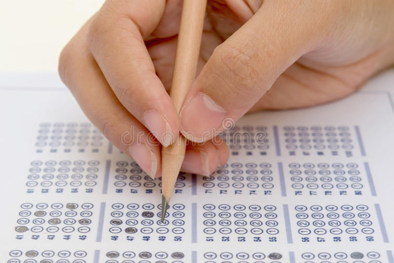 Answer sheet. Standardized test form with answers bubbled in and a pencil, focus on anser sheet royalty free stock photography