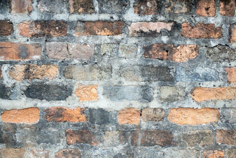 Antaño muro de ladrillo obsoleto con textura de fondo de cemento de piedra gris manchado a nadie fotos de archivo libres de regalías