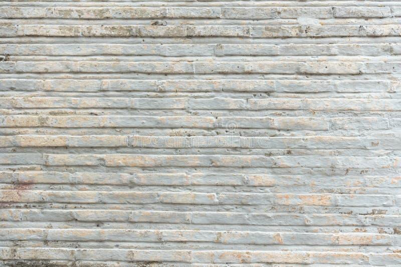 Antaño muro de ladrillo obsoleto con textura de fondo de cemento de piedra gris manchado a nadie imagenes de archivo