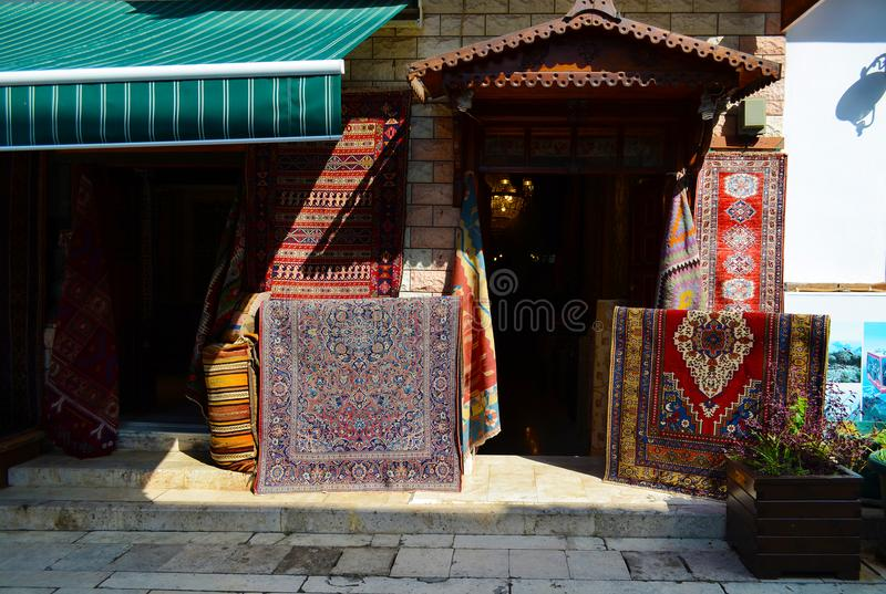 Antalya, Turkey, May 10.05.2018. Enter in a Store carpets and old things in the easten town stock photography
