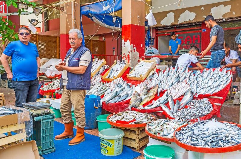 Fish store in Antalya market. ANTALYA, TURKEY - MAY 12, 2017: The fish store in Muratpasa Friday market boasts wide range of fresh sea fish in boxes and bowls royalty free stock photo