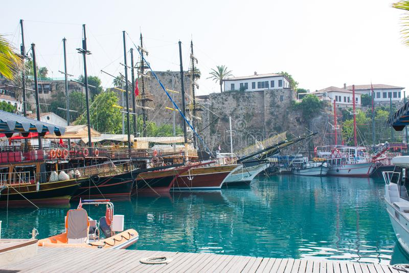 Antalya, Turkey, old sea port, in the sunlight in the summer, ships antique stock photo