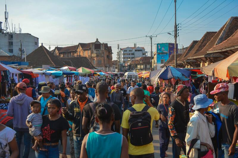 A crowd of African people in the market, Antananarivo street full of pedestrians and street vendors stock image