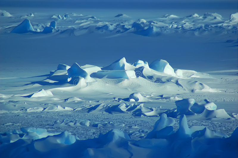 Antarctic snowfield. Endless Antarctic snowfield in blue stock photography