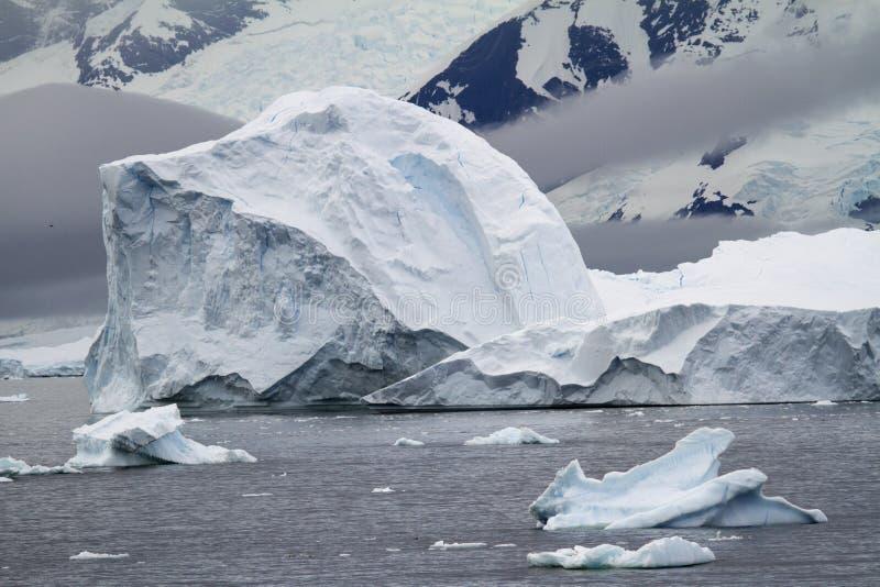 Antarctica - Non-Tabular Iceberg. Dome Iceberg - Iceberg Drifting In The Ocean - Antarctica In A Cloudy Day stock images