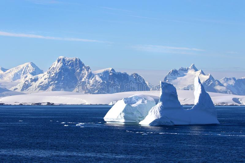 Antarctica on a Sunny day- Antarctic Peninsula - Huge Icebergs. And blue sky stock photo