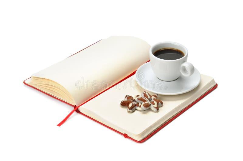 anteckningsbok för kaffekopp arkivfoto