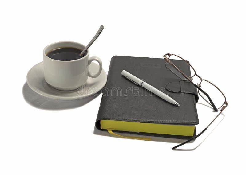 Anteckningsbok med pennan och kaffe fotografering för bildbyråer
