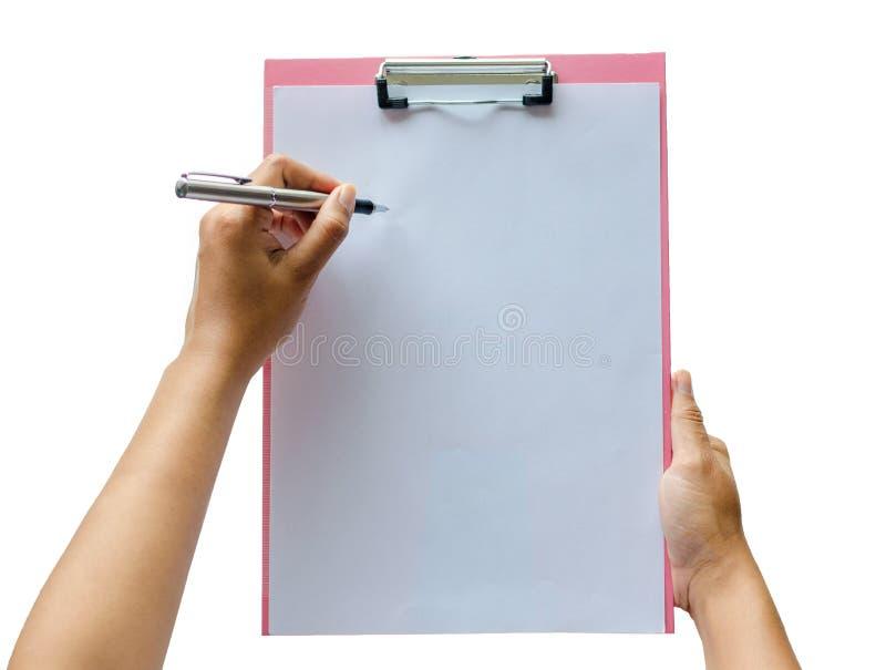 Anteckningsbok och penna i hand På vitbakgrund arkivbilder