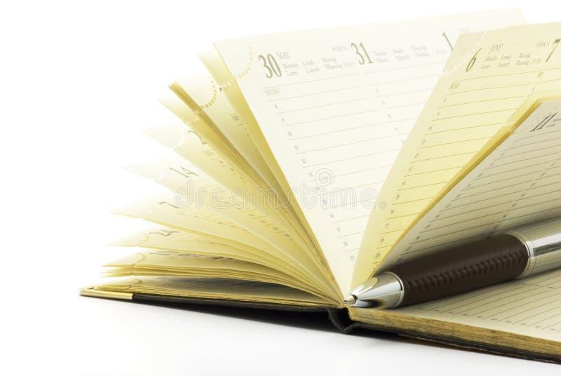 anteckningsbokpenna royaltyfri bild