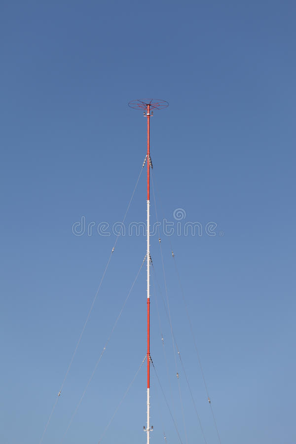 Antenna. Tower for radio mobile telecommunication antenna against a blue sky royalty free stock photo