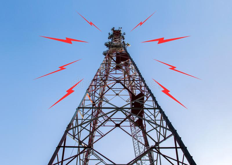 Antenna cell tower on a background of blue sky stock photography