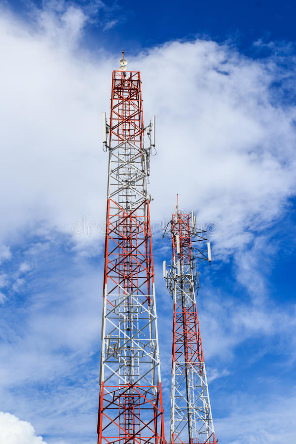 Antenna and cellular tower in blue sky royalty free stock photo