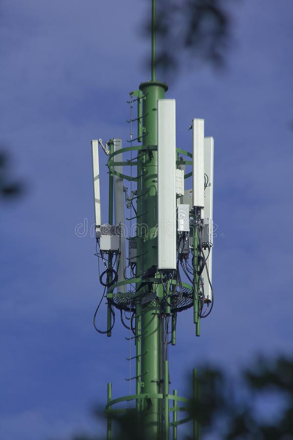Antenna is a device that transmits through the air. To the transceiver royalty free stock images